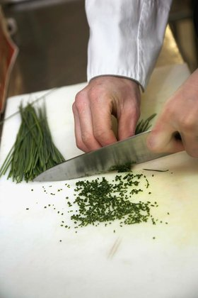 Person chopping chives