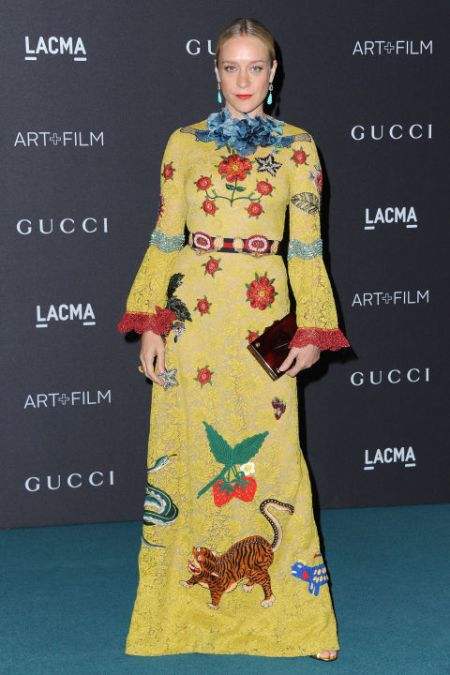 Chloe Sevigny takes a more decorated route in her conservative gown.