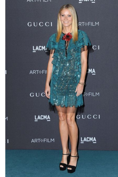 Gwyneth shows some leg in her sparkly teal number