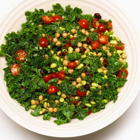Our famous kale salad, with mint, edamame, chickpeas, tomatoes and dried cranberries in a lemon herb dressing.