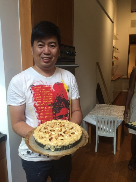 A proud baker presenting his tart