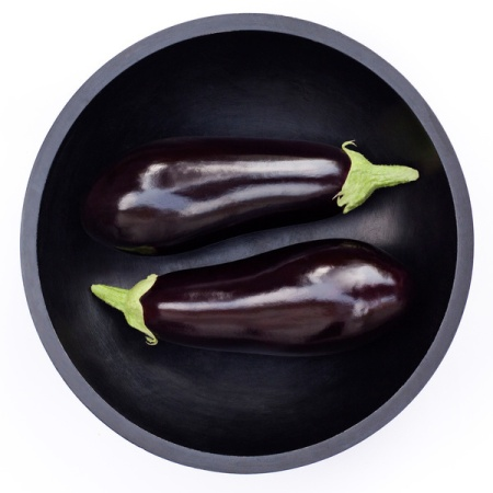 Two Eggplants in Round Bowl, High Angle View
